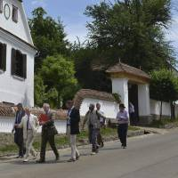 Britain's Prince Charles (second left) walks last year in front of the guesthouse of Hungarian Count Tibor Kalnoky (fourth left) as he tours in Miclosoara, Transylvania, Romania. Charles has returned to Romania, where he has a charity that promotes skills and training in rural Transylvania. | EDIT KATAI / FILE, MTI VIA AP