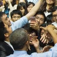 U.S. President Barack Obama greets members of the audience after speaking at the Young Southeast Asian Leaders Initiative town hall event in Ho Chi Minh City on Wednesday. | AFP-JIJI