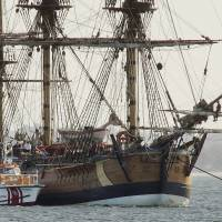 The Endeavour, a replica of Captain James Cook's ship of discovery, lies at anchor in Botany Bay in Sydney in April 2005. | AP