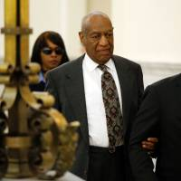 Cosby must stand trial in decade-old alleged sexual assault of woman who claims she was drugged