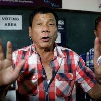 New Philippine leader seen as both emancipator and looming dictator