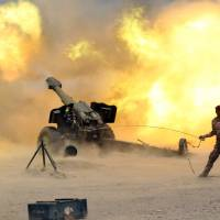 Iraqi forces push into Fallujah as Islamic State bombings kill 24