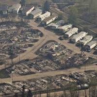 Alberta offers app on fire damage surveillance, warns homeowners satellite scenes may be traumatic