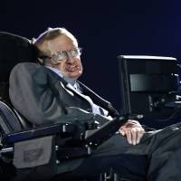 Professor Stephen Hawking speaks during the Opening Ceremony for the 2012 Paralympics in London. Hawking was interviewed on British TV Monday, saying the U.K. should stay inside the European Union because of its support for research, and he cannot fathom the popularity of presumptive candidate for U.S. president Donald Trump, saying he 'seems to appeal to the lowest common denominator.' | AP