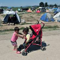 Greece readies riot cops to clear squalid Idomeni camp as moms with babies look to God