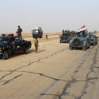 U.S. airstrike claims 'high-value' Islamic State pair; Iraqi troops clear key remote town