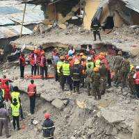 Kenyan rescuers race to free woman trapped in rubble of collapsed building