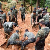 Sri Lanka rescuers use hands, sticks to search for over 200 families feared buried by landslides