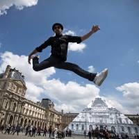 Louvre Pyramid vanishes in French street artist's optical illusion