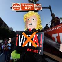 Trump foes figure as U.S. cities' May Day marches call for immigrant, and worker, rights