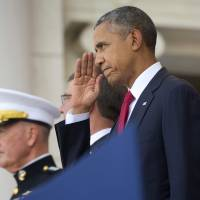 Taps played as Obama marks Memorial Day at Arlington, urges Americans to be better