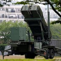 A Patriot Advanced Capability-3 (PAC-3) missile battery is seen at the Defense Ministry in Tokyo on Tuesday. | REUTERS