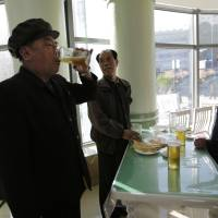 Pyongyang Scientists' Street stand-up bars offer Taedonggang suds on the cheap for tired masses