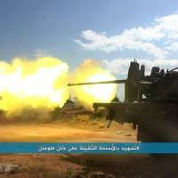 This image posted on the Twitter page of Syria's al-Qaida-linked Nusra Front on May 5 shows a militant from the group firing a weapon during clashes with Syrian regime forces and pro-government militiamen in the town of Khan Touman, Syria.   AP