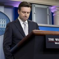 White House press secretary Josh Earnest pauses as he speaks during the daily news briefing at the White House in Washington Thursday. Earnest discussed President Barack Obama's health care law and other topics.   AP