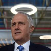 Australian leader's poll numbers sag two weeks into campaign