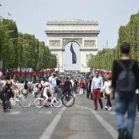 Pedestrians take over Champs-Elysees as Paris goes green for the day