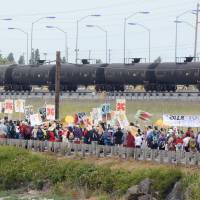 Police arrest 52 climate activists blocking railroad near Washington refineries