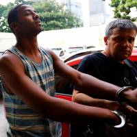 Rio cops hunt favelas for six in alleged gang rape of girl, 16, seen on video