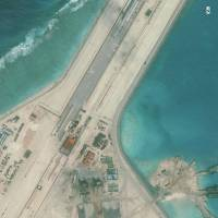 The center of a Chinese runway on Subi Reef in the South China Sea is seen in this January satellite image. | REUTERS