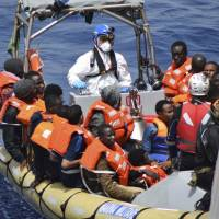 This undated image made available Monday by the Italian Navy Marina Militare shows migrants being rescued at sea. Survivor accounts have pushed to more than 700 the number of migrants feared dead in Mediterranean Sea shipwrecks over three days in the past week, even as rescue ships saved thousands of others in daring operations. | ITALIAN NAVY VIA AP