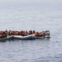 This undated image made available Monday by the Italian Navy Marina Militare shows migrants being rescued at sea. | ITALIAN NAVY VIA AP