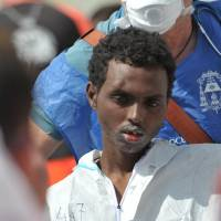 The Italian Navy ship Vega arrives with more than 600 migrants and refugees on Sunday in the port of Reggio Calabria, southern Italy. | AFP-JIJI