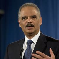 Snowden did 'service' in stoking surveillance debate but should still stand trial: Holder