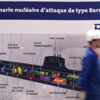France wins bid to build Australian sub fleet but U.S. gets to install 'eyes, ears, sword' in them