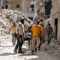 Airstrikes on rebel-held Syria town kill at least 12, including extended family trying to reach shelter