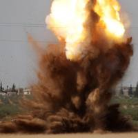 Russian planes pound rebel-held areas of Aleppo