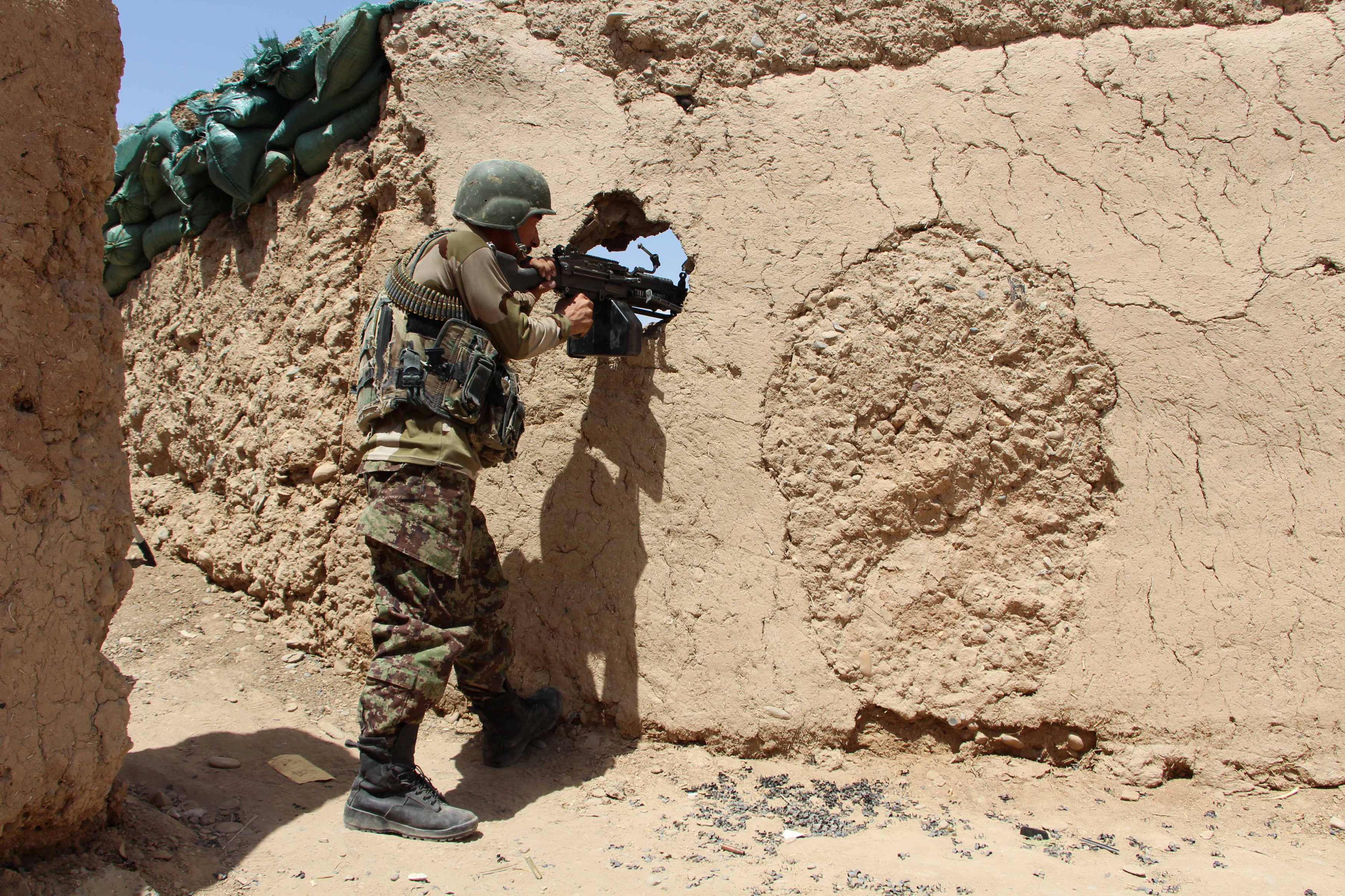 An Afghan National Army (ANA) soldier mans his position at an outpost in Babaji area of Lashkar Gah Helmand province, Afghanistan, Sunday. | REUTERS