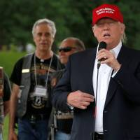 Trump bends bikers' ears with pitch for veterans, says those in U.S. illegally fare better