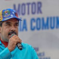 Venezuelan leader Maduro seizes factories and arrests owners under emergency decree