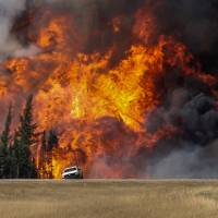 Massive Alberta wildfire poised to rage into Saskatchewan, burn for months