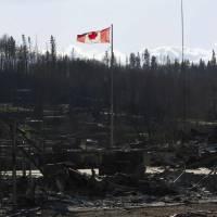 Alberta's 'out of control' wildfire has jumped border into Saskatchewan