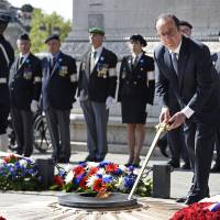Hollande marks end of WWII as French village honors 1944 lynch mob victims