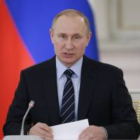 Russian President Vladimir Putin holds a meeting of a committee on preparations for Victory Day in WWII in the Kremlin on Tuesday.  Russia celebrates Victory Day on May 9. | AP
