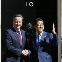 British Prime Minister David Cameron meets with Prime Minister Shinzo Abe at Downing Street in London on Thursday. | AP