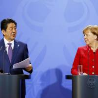Abe meets Merkel during Germany visit; leaders differ on how to fix world economy