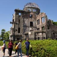 Hiroshima A-bomb museum chief hopes Obama will visit displays 'as a father'