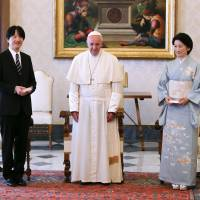 Prince Akishino and his wife, Princess Kiko, pose with Pope Francis during a private audience at the Vatican on Thursday. | AFP-JIJI