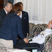 ALS patient Hiroki Okabe (second from right) meets with Lower House Speaker Tadamori Oshima (second from left) Tuesday in the Diet. | KYODO