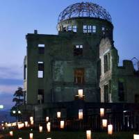 Paper lanterns glow in front of the A-bomb Dome at Hiroshima's Peace Memorial Park on August 6, 2000. | REUTERS
