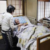 Elderly people with low incomes receive care at the Nishimizue no Mori nursing facility in Edogawa Ward, Tokyo, on April 19. | KYODO