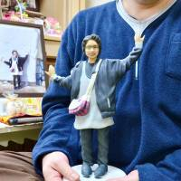 Bereaved father finds solace in figurine of daughter