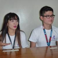 Filipino health workers Mary Jane Balberona (left), 29, and Angelito Custodio, 25, speak about their preparations for Japan during an interview on April 25. | KYODO