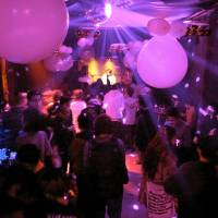 Noon, a nightclub in Osaka, is seen in December 2011. In April 2012, the manager was prosecuted for allowing patrons to continue dancing after midnight. The episode led to a campaign to revise a law crafted during the nation's postwar turmoil. | KYODO