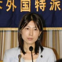 Ayaka Shiomura, a member of the Tokyo Metropolitan Assembly, addresses a news conference at the Foreign Correspondents' Club of Japan in June 2014. | KYODO