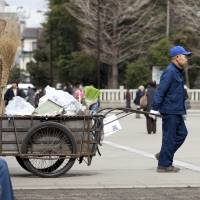 A man wheels his cart on the grounds of Sensoji Temple in Tokyo's Asakusa district. According to the metropolitan government, the number of homeless people in the capital hit a record low this past winter, but advocates say they are becoming increasingly harder to track. | ISTOCK